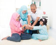 Malay family teamwork theme on home Stock Photos