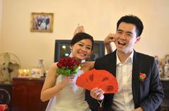 asian chinese bride and groom on their actual wedding day - stock photo