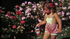 Little boy and girl water flowers cute vintage film Circa 1940s 0106 Stock Footage