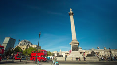Buses turning around Trafalgar Square in London, United Kingdom Stock Footage