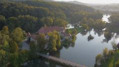 AERIAL VIEW: castle on an island in the river - stock footage