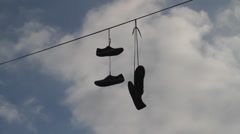 shoefiti - shoes on power line  1/2 - stock footage