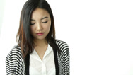Stock Video Footage of asian girl isolated on white worried with help sign