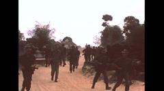 Vietnam War - Soldiers Walking Village - 02 Stock Footage