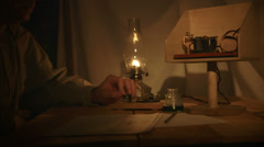 Telegraph office in a dimly lit tent Stock Footage