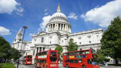 Time lapse of St. Paul's Cathedral in London with red buses passing, editorial Stock Footage