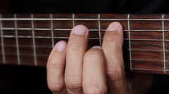left human hand clamps the strings - stock footage
