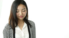 Asian girl isolated on white with hire me sign Stock Footage