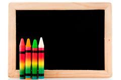 blackboard with chalks - stock photo