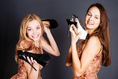 two girlfriends during the fitting - stock photo