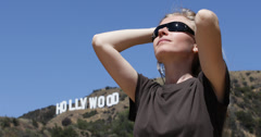 Ultra HD 4K Girl relax enjoy play blonde hair woman hollywood sign visit sunny Stock Footage
