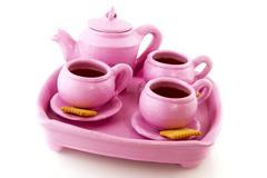 Pink handcraft crockery Stock Photos