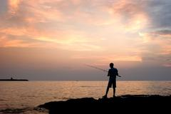 the lonely fisherman - stock photo