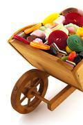 Wheel barrow with candy Stock Photos