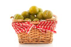 cheerful basket reine claude plums - stock photo