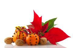 Stock Photo of orange with cloves and poinsetta
