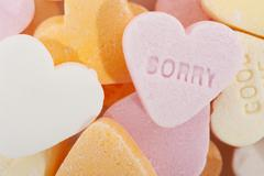 Sorry in candy hearts Stock Photos