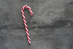 generic machine made christmas candy cane ornament on rustic style background - stock photo