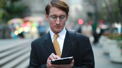 Caucasian businessman in New York city walking ipad Stock Footage