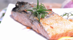 Rotating fried salmon Stock Footage