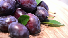 Portion of fresh rotating plums Stock Footage