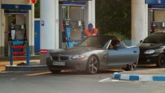 Classy elite car drives to gas fueling station, gasoline petrol, click for HD Stock Footage