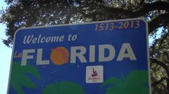 Florida, CU Welcome to Florida sign, ZO to WS Rick Scott Governor Stock Footage