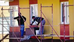 Man plastering insulation panels with trowel Stock Footage