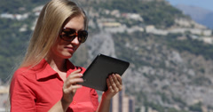 Ultra HD 4K Blonde Businesswoman work electronic tablet out office Monaco city Stock Footage