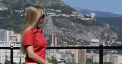 Ultra HD 4K Blonde Tourist woman girl admire luxury Monaco cityscape Monte Carlo Stock Footage