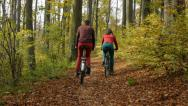 Stock Video Footage of two cyclists in a park in autumn