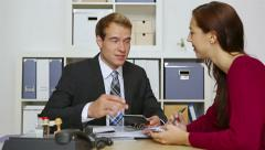 businessman consulting woman in office - stock footage