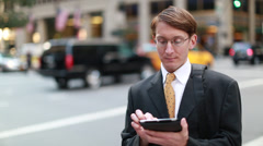 Caucasian businessman in New York city texting iPad tablet - stock footage