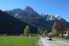 straight road to the mountains - stock photo
