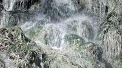 Wilderness waterfall splash on rocks and moss HD 0001 Stock Footage