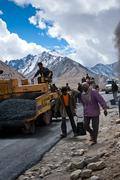 Indian people working at road construction - stock photo