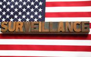 Stock Illustration of surveillance word on USA flag