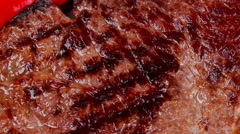 Beef steak with potato chips and dry red hot chili peppers Stock Footage