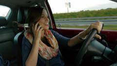 Driving talking on the phone Stock Footage