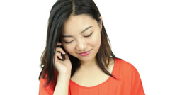 Asian girl orange sundress isolated on white happy with phone call Stock Footage