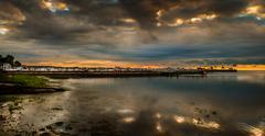 Orange Sunrise over Marina in Michigan. - stock photo