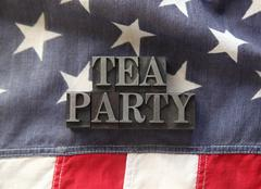 tea party in metal type on American flag - stock photo