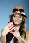 girl with mobile phone smartphone reads message - stock photo