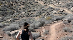 Woman Trail Running with Dog in the Desert 2 Stock Footage