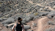 Stock Video Footage of Woman Trail Running with Dog in the Desert 2