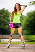 woman roller skating sport activity in park - stock photo