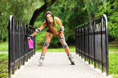 Stock Photo of woman roller skating sport activity in park