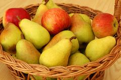 basket with pears and apples - stock photo