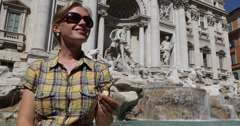 Ultra HD 4K Happy Tourist Young Woman Girl Throwing Coin in Trevi Fountain Water Stock Footage