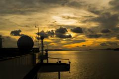 sunset with ship radar silhoutte - stock photo